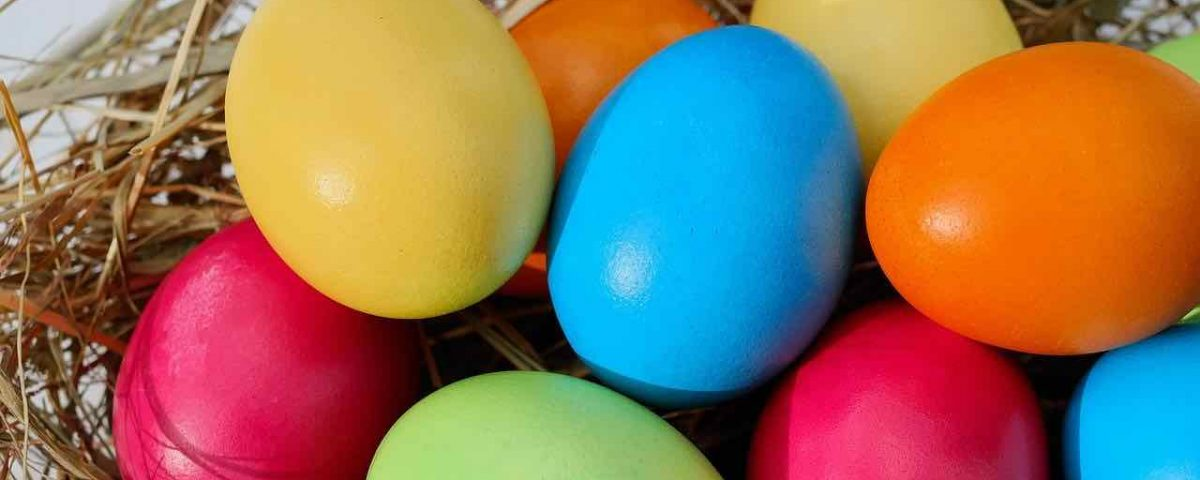 Image of some coloured eggs in a nest